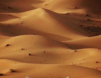 the sand dunes of Erg chebbi with a camp, a must see attraction with our 3 days desert tour from Marrakech to Fes